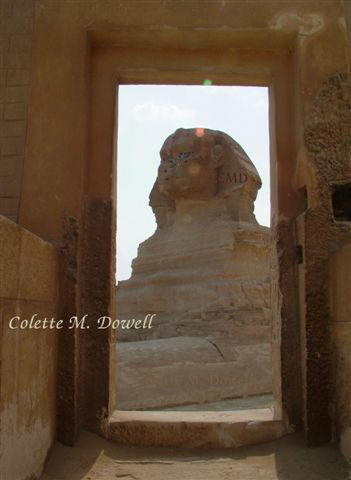 Image of Sphinx looking through Valley Temple door photograph by Colette Dowell